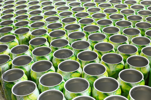 Many empty aluminum cans for drinks move on conveyor