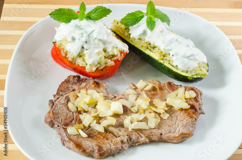 Beef steak with fried onion and stuffed vegetables