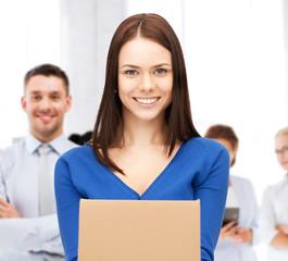 smiling woman holding cardboard box