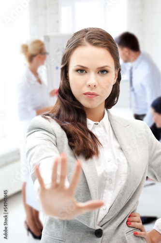 angry businesswoman showing stop gesture