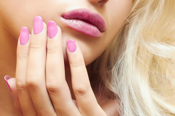 lips,nails and hair of beautiful blond girl. beauty woman