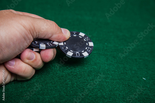 Hand throwing a poker chip