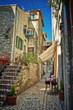Traditional old street of Croatia with cafe - 54974695