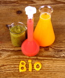 Biochemistry concept and juices from test tube poster