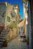 Traditional old street of Croatia with cafe