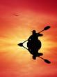 Kayaker silhouette at sunset