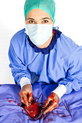 Doctor operating on patient heart
