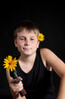 teenager with a gun and flowers
