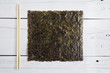 Dried seaweed and chopsticks on a white table