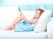 little girl holding a e-book