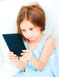 little girl holding a e-book