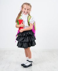 cute little girl in school uniform