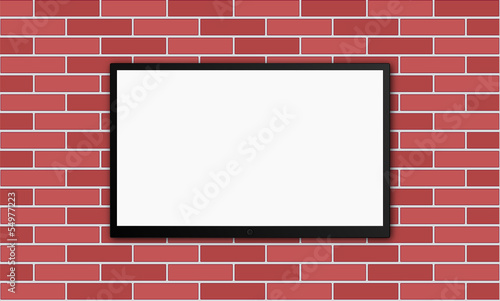 flat modern plasm tv on brick wall