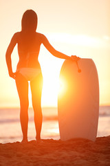 Surfer beach woman with water sport bodyboard