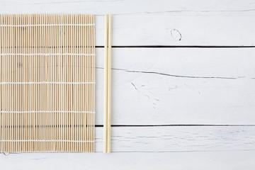 Makisu and chopsticks on a white table