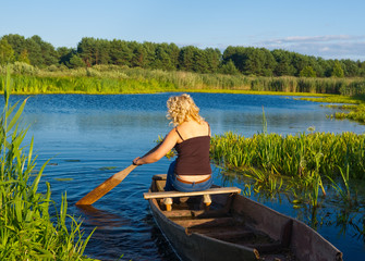 Woman rowing on river