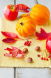 Apples, leaves and golden acorn  squash on wood table