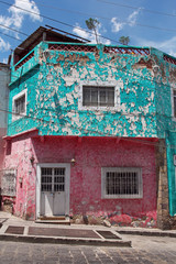 vintage mexican building with peeling paint