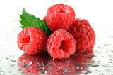 Ripe sweet raspberries with drops, close up