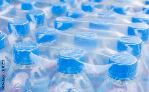 bottled water in plastic wrap