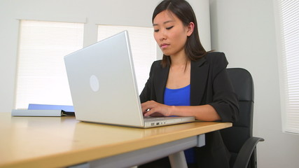 Asian businesswoman working at desk