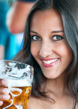 Close-up of young woman with a glass of beer