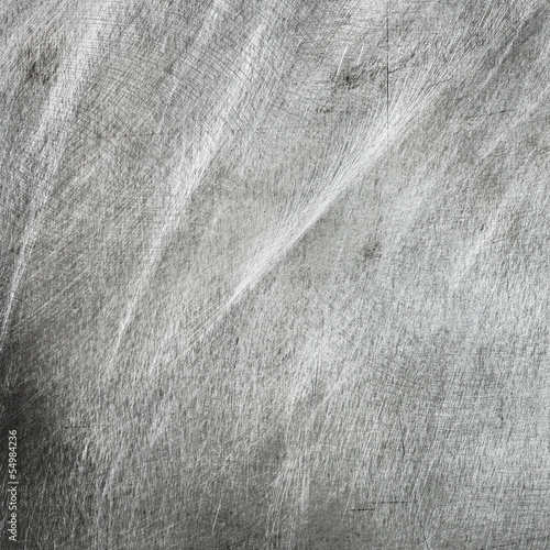Scratched grey metal texture, grunge background