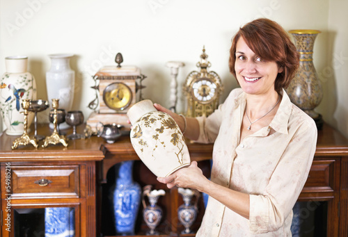 Woman with antique collection