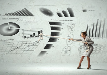 Businesswoman and business diagrams