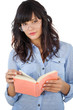 Beautiful woman wearing glasses and holding book