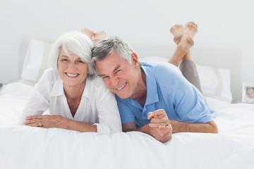 Beautiful couple lying on bed