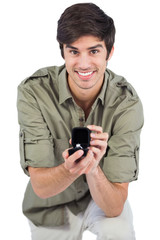 Handsome man offering engagement ring