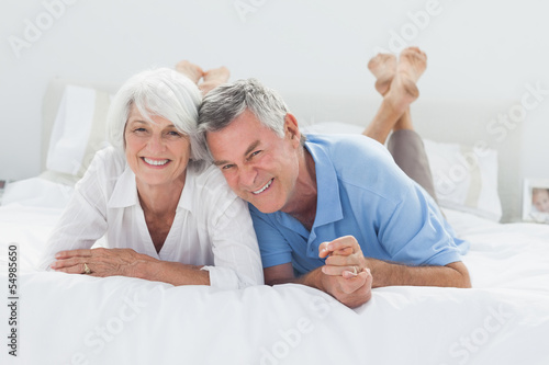 Beautiful couple lying on bed