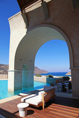 Vertical view of arch pool terrace on summer resort (Greece)