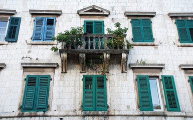 wall of mediterranean house with shatter windows, Montenegro