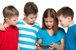 Children plaing with a new gadget