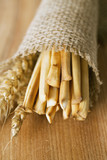 bread sticks and wheat in burlap