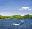 Woman boating on lake - 54987238