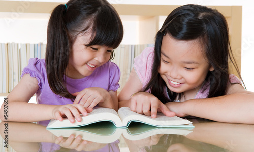 Asian girls share a book