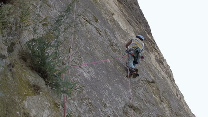 Aid climber ascending rope using jumars
