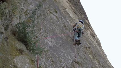 Aid climber ascending rope using jumars