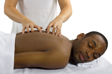 young female therapist examining male patient's spinal column