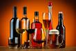 Leinwanddruck Bild - Bottles and glasses of alcohol drinks