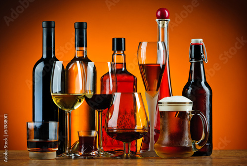 Bottles and glasses of alcohol drinks - 54988011
