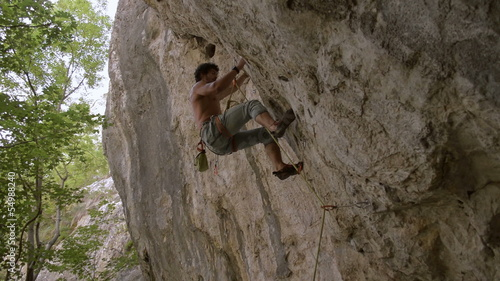 rock climber climbs difficult route and falls