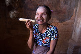 Old Asian woman smoking tobacco. Bagan, Myanmar.