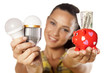 Smiling girl shows that you can save money with LED bulbs