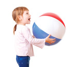 Adorable baby playing with a colorful beach ball