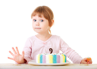 Baby girl and her birthday cake