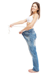 Slim woman in oversize jeans
